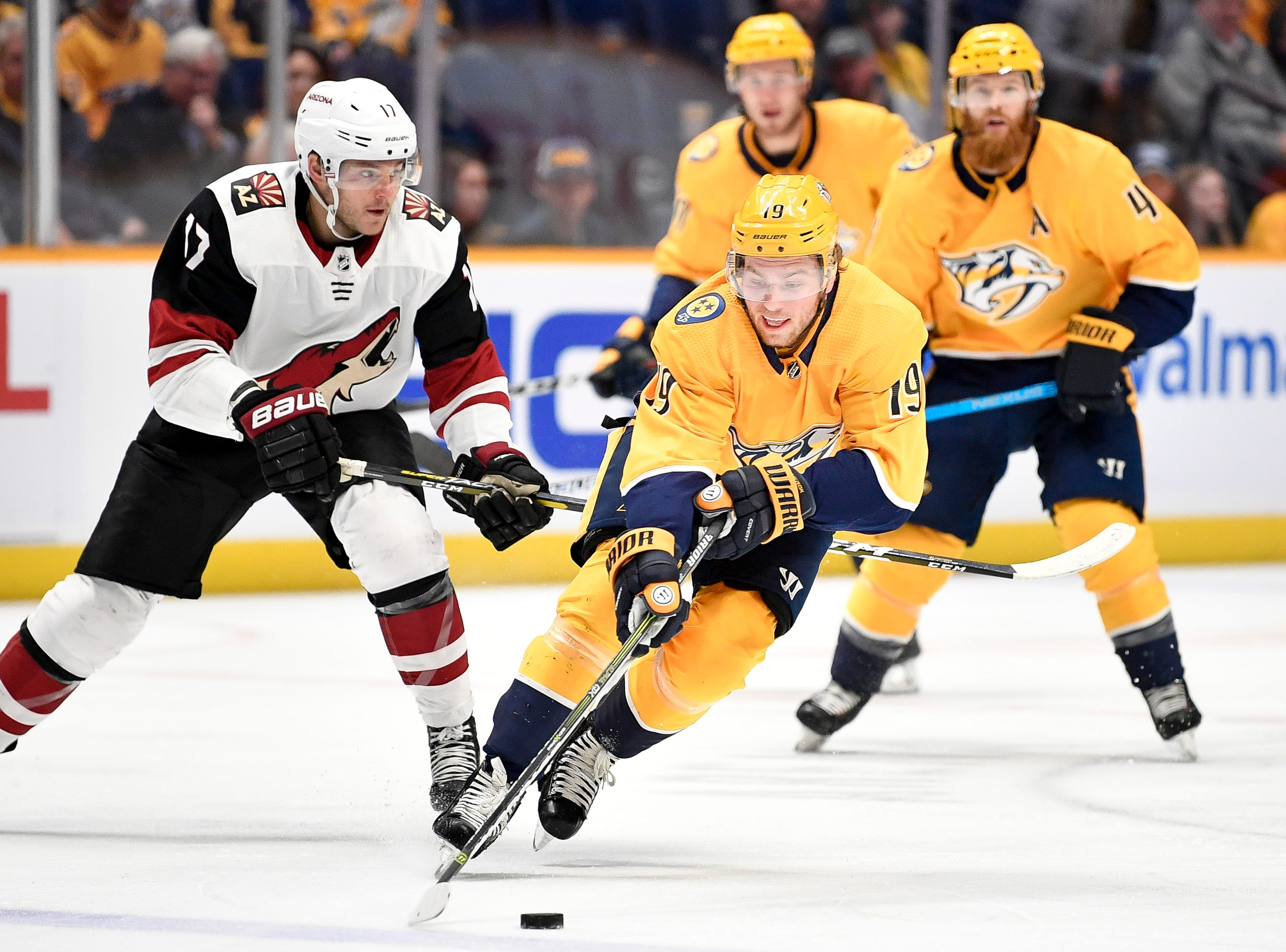 Nashville Predators center Calle Jarnkrok (19) advanc es past Arizona Coyotes center Alex Galchenyuk (17) during the first period at Bridgestone Arena in Nashville, Tenn., Tuesday, Feb. 5, 2019.