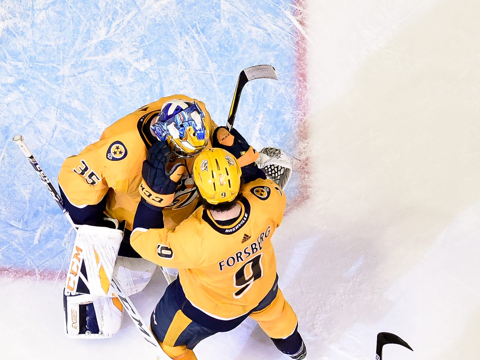 Nashville Predators goaltender Pekka Rinne (35) and left wing Filip Forsberg (9) celebrate their victory over the Arizona Coyotes at Bridgestone Arena in Nashville, Tenn., Tuesday, Feb. 5, 2019.