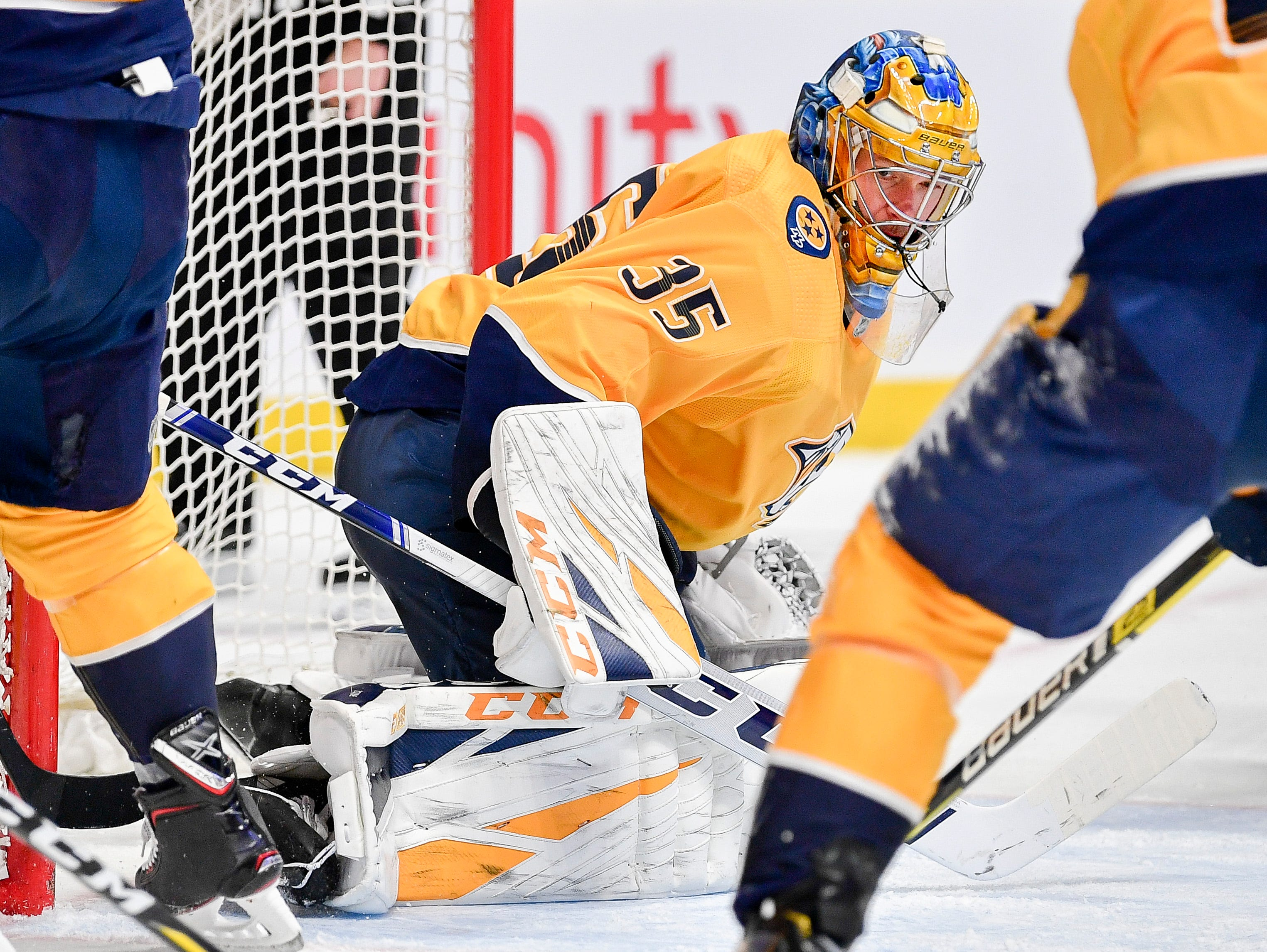 Nashville Predators goaltender Pekka Rinne (35) keeps his eye on the puck during the second period against the Arizona Coyotes at Bridgestone Arena in Nashville, Tenn., Tuesday, Feb. 5, 2019.