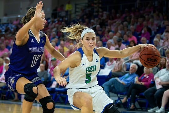 FGCU's Lisa Zderadicka dribbles the ball against North Alabama's defense during FGCU's home game at Alico Arena in Fort Myers.