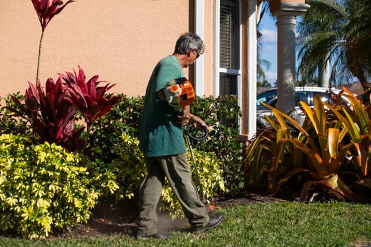 Lee Haddox does landscaping work in Naples on Wednesday, Feb. 6, 2019.