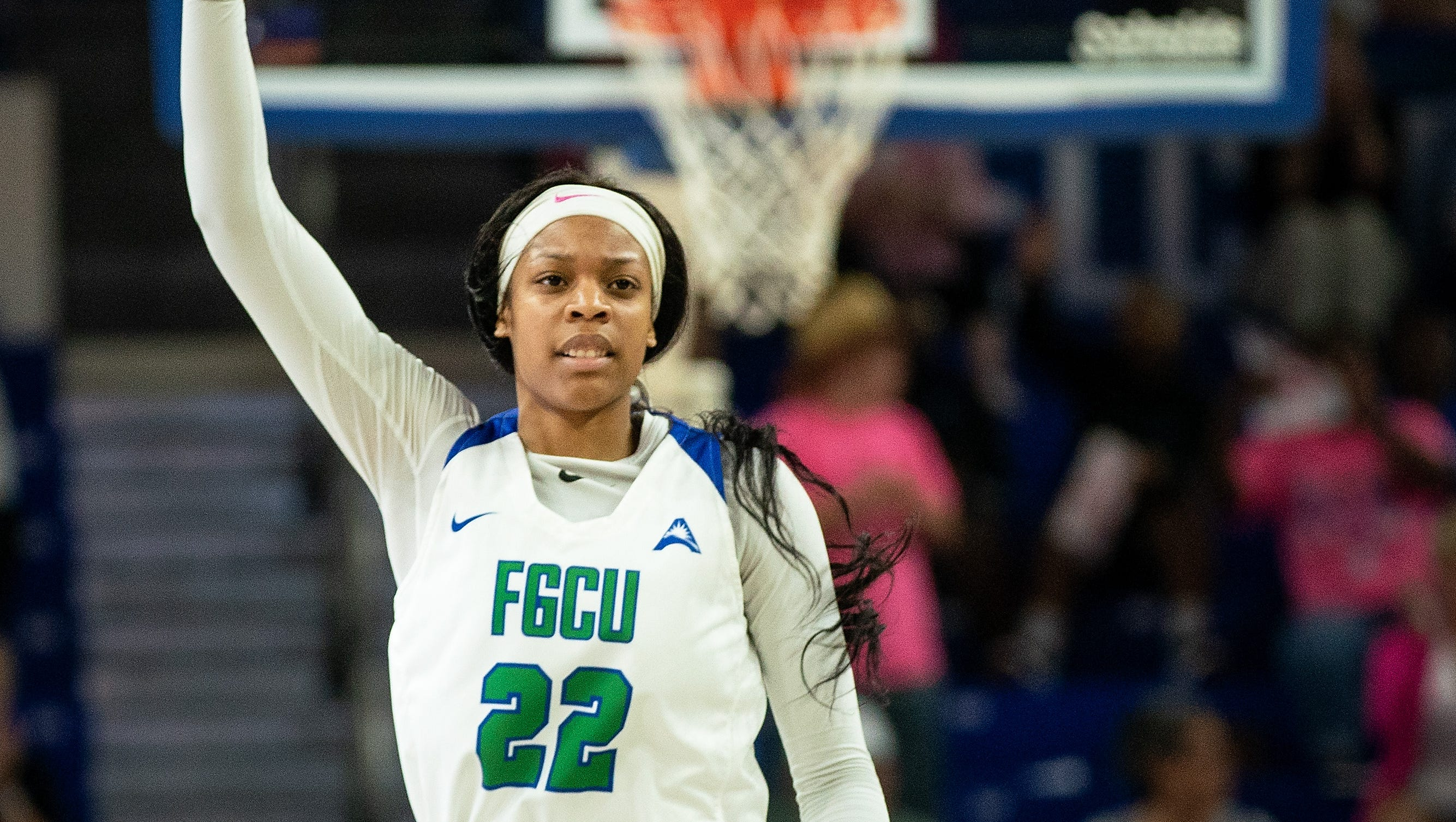 FGCU's Destiny Washington puts the sign up after making three points shot during FGCU's home game against North Alabama at Alico Arena in Fort Myers.