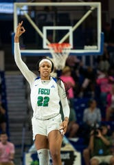 FGCU's Destiny Washington puts the sign up after making a 3-pointer during FGCU's home game against North Alabama at Alico Arena in Fort Myers.