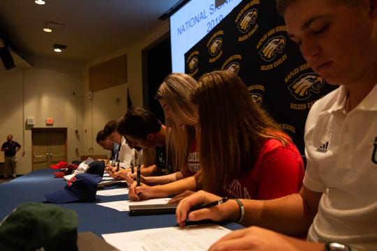 Ten Naples High School athletes signed letters of intent with various colleges on National Signing Day in Naples on Wednesday.