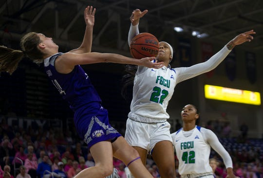 Florida Gulf Coast University's Destiny Washington defends the net against North Alabama'S Brittany Panetti, Tuesday, Feb. 5, 2019, at Alico Arena in Fort Myers.