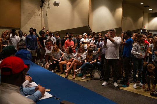 Friends and family filled the Naples High School to watch student athletes signed letters of intent with various colleges on National Signing Day at Naples High School on February 6, 2019.
