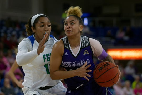 FGCU's Kerstie Phills guards North Alabama's Kenosha Coulson on Tuesday at Alico Arena.