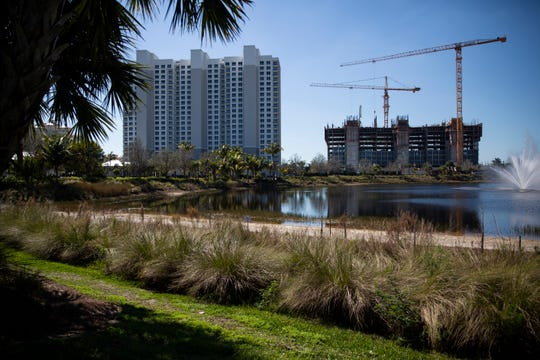Crews work on constructing the second Kalea Bay residential building off Vanderbilt Drive in North Naples, on Wednesday, Feb. 6, 2019.