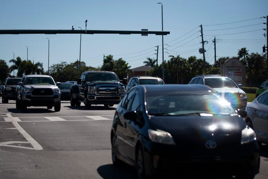 A constant stream of traffic crosses the intersection of Goodlette-Frank and Pine Ridge roads in Naples, on Wednesday, Feb. 6, 2019.