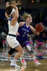 FGCU's Lisa Zderadicka draws a charge on North Alabama's Ivy Wallen on Tuesday at Alico Arena.