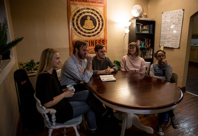 Denison students from left to right, Summer Aldred, Kellon Patey, Andrew Boyle, Taylor Shook, Ambar Deleon, talk about their experiences with the Hull house and why they decided to leave Denison's campus to live in Newark.