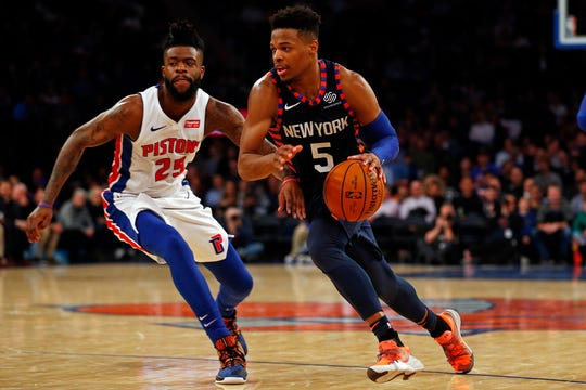 New York Knicks guard Dennis Smith Jr. (5) drives to the basket past Detroit Pistons guard Reggie Bullock (25) during the second half at Madison Square Garden.