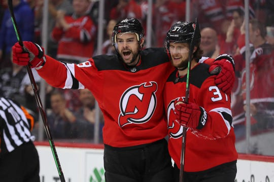 Feb 5, 2019; Newark, NJ, USA; New Jersey Devils right wing Drew Stafford (18) and center Pavel Zacha (37) celebrate Zacha's goal during the second period of their game against the Los Angeles Kings at Prudential Center.
