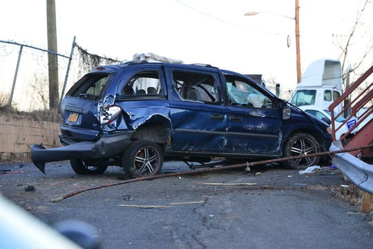 A minivan crashed through a utility pole and a fence before coming to a stop leaving at least one person dead in Paterson on Wednesday February 6, 2019. The accident occurred on Route 20 at 33rd St.