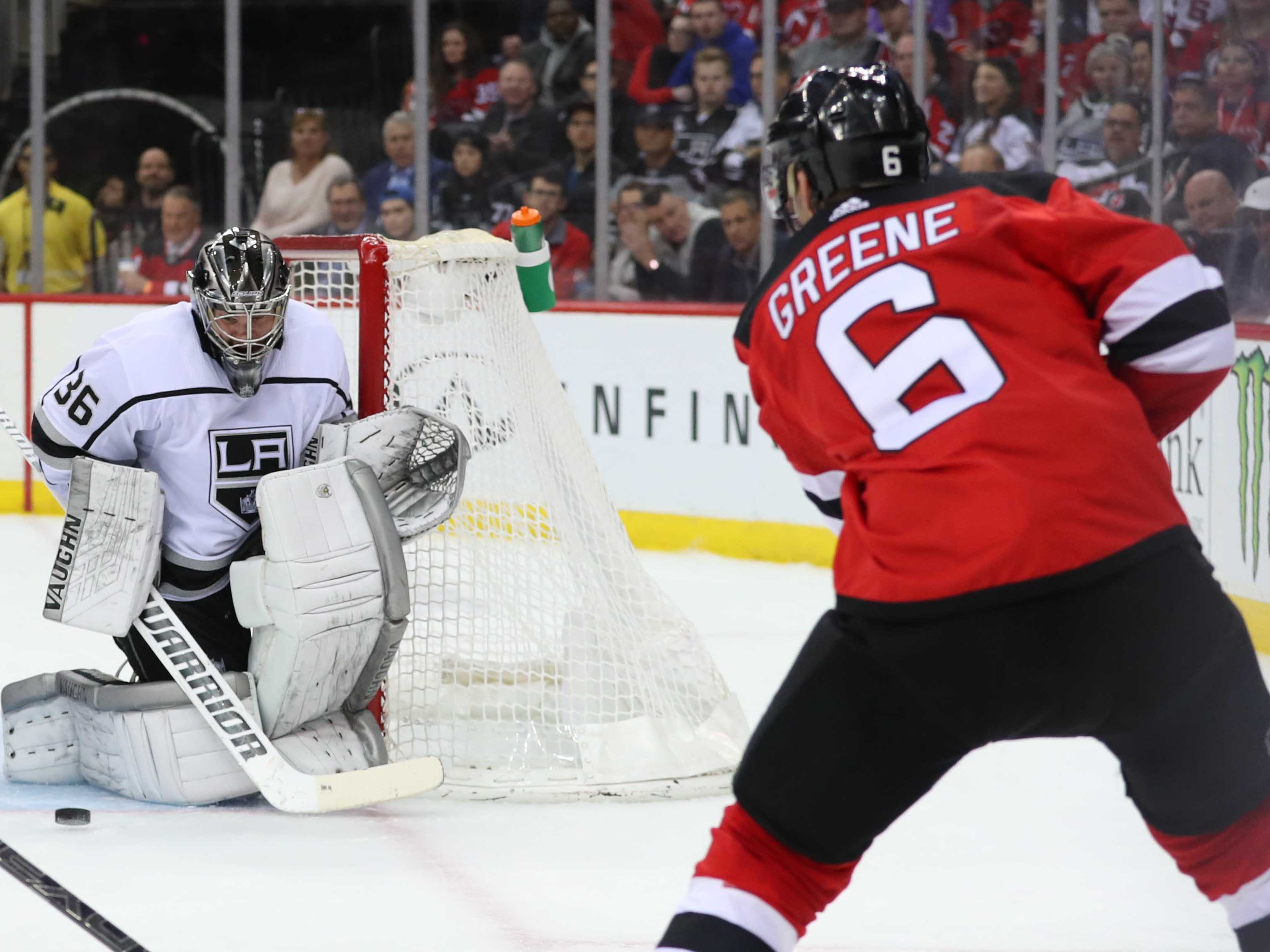 Feb 5, 2019; Newark, NJ, USA; New Jersey Devils defenseman Andy Greene (6) shoots the puck wide of Los Angeles Kings goaltender Jack Campbell (36) during the second period at Prudential Center.