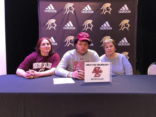 Paramus Catholic lineman Christian Mahogany was joined by his mother Francine (left) and grandmother Barbara Cerniglia as he committed to play football at Boston College on Wednesday, Feb. 6, 2019.