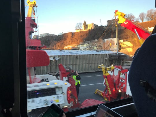 An overturned tractor trailer on the helix of the New Jersey side of the Lincoln Tunnel snarled the morning commute and closed the bus lane.