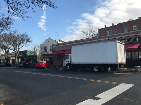 A delivery truck parked on Oak Street in the RIdgewood downtown in the early afternoon.