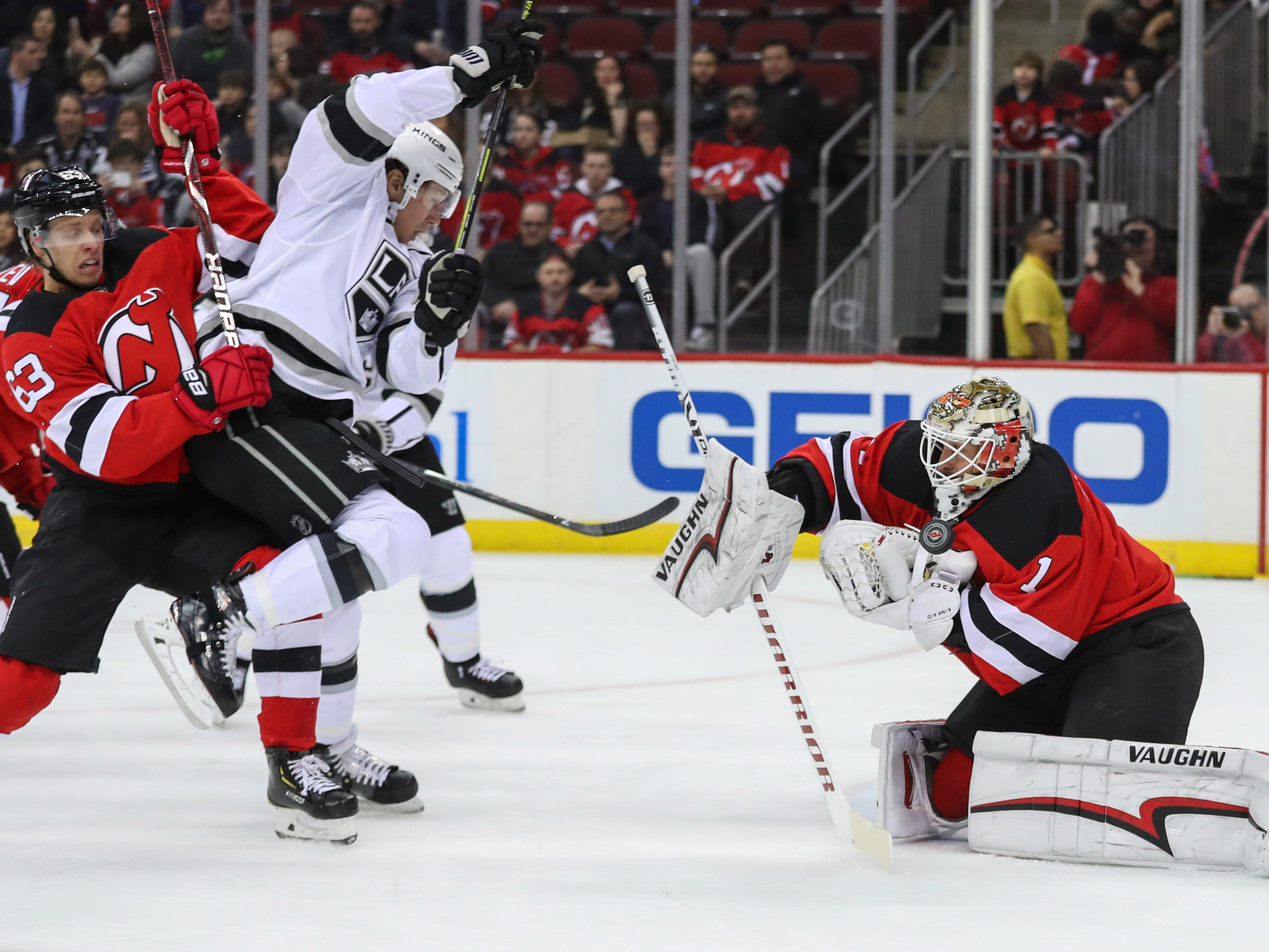 Feb 5, 2019; Newark, NJ, USA; New Jersey Devils goaltender Keith Kinkaid (1) makes a save during the first period against the Los Angeles Kings at Prudential Center.