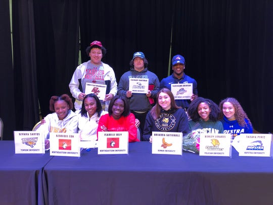 Nine senior athletes were honored at Paramus Catholic's Signing Day ceremony on Thursday, Feb. 6, 2019. FRONT ROW, from left: Kiyara Santos (Towson track & field), Kennedee Cox and Isabelle Dely (Northeastern track & field), Brianna Gutierrez (Rowan swimming), Ashley Linares (Felician track & field) and Tanaya Perez (Hofstra soccer). BACK ROW, from left: Football players Christian Mahogany (Boston College), Zach Hartman (Wagner) and Tahshawn Brinson (Stony Brook).