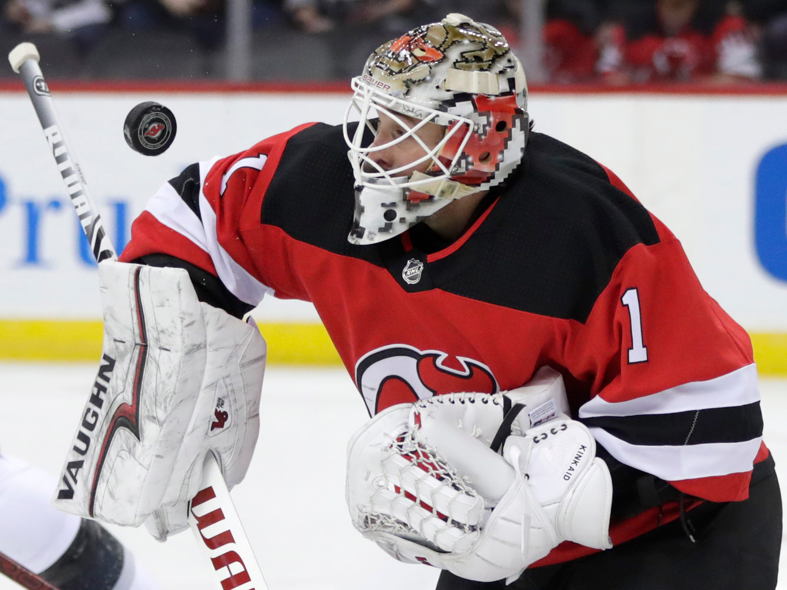 New Jersey Devils goaltender Keith Kinkaid (1) makes a save against the Los Angeles Kings during the first period of an NHL hockey game Tuesday, Feb. 5, 2019, in Newark, N.J.