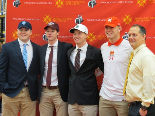 Bergen Catholic football on national signing day: From left: Sean Connolly (Rhode Island), Garrett Cody (Fordham), Griffin McGovern (Brown), Tyler Devera (Maryland), and Crusaders coach Vito Campanile.