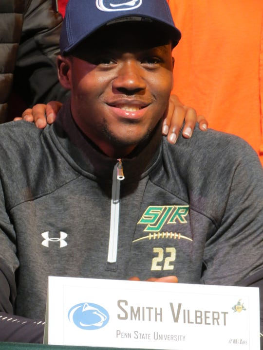 St. Joseph's Smith Vilbert signed with Penn State, one of several Green Knights to sign letters of intent to play college football in Montvale on Wednesday, Feb. 6, 2019.