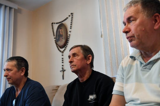 (from left) Milan Knezevic, Slobodan Knezevic and Marko Knezevic worked at Marcal Paper. After the devastating fire at Marcal Paper, their future is uncertain. The Knezevic brothers at Marko's home on Wednesday, February 6, 2019.