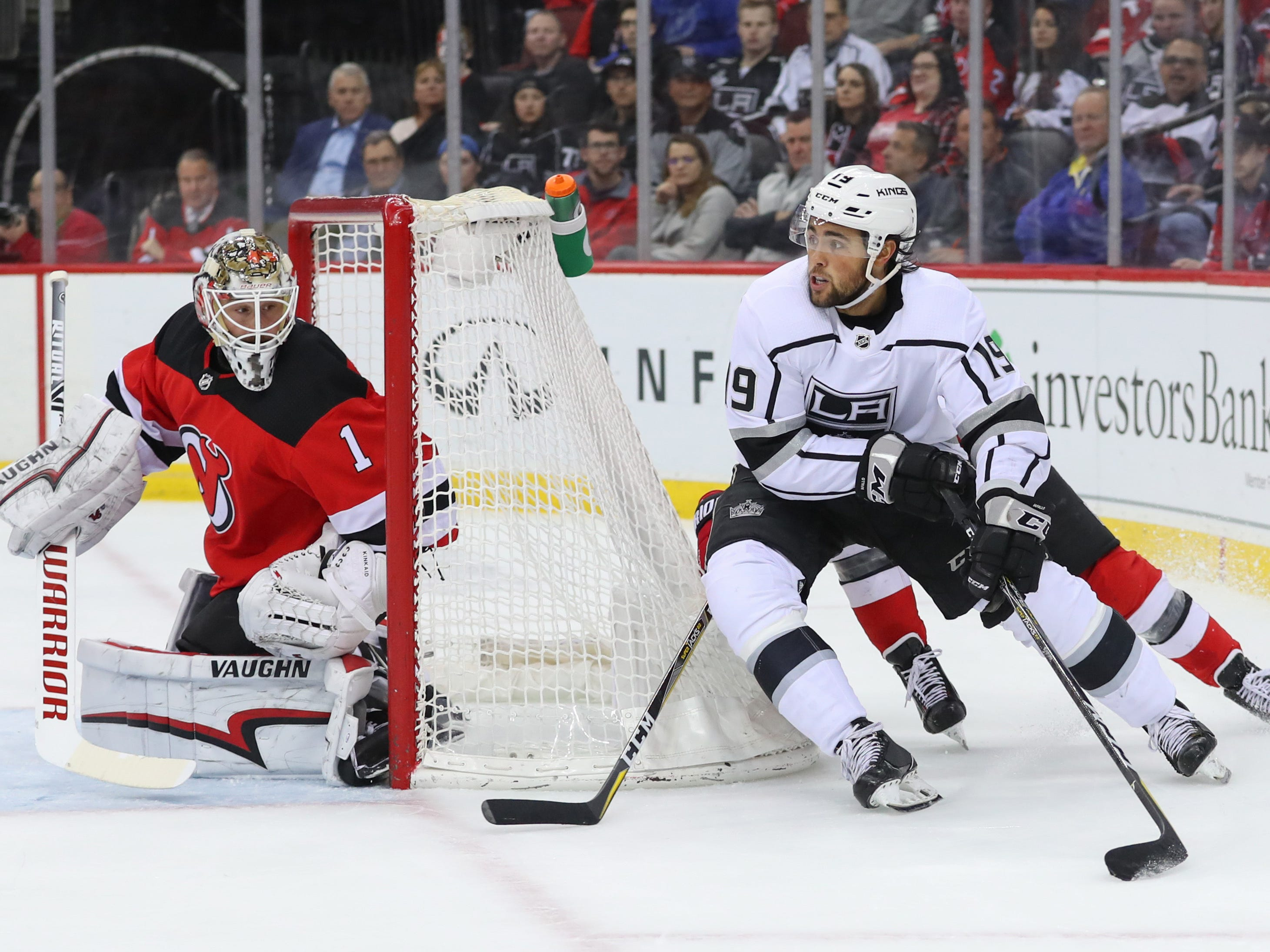 Feb 5, 2019; Newark, NJ, USA; Los Angeles Kings left wing Alex Iafallo (19) skates with the puck as New Jersey Devils goaltender Keith Kinkaid (1) defends during the first period at Prudential Center.