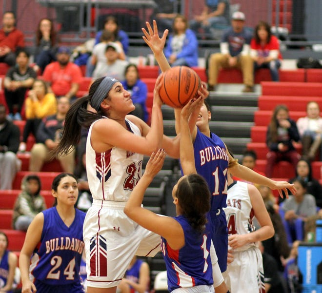 Senior Lady 'Cat post Vanessa Garcia (23) put up a career-high in points (13) and rebounds (19) to go along 5 blocks in Deming High's 64-57 home victory over Las Cruces High Tuesday night.