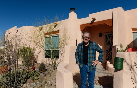 In January 2019, Richard Myers stands outside his Talavera home, where he is believed to have become infected with valley fever after removing vegetation to widen a driveway.