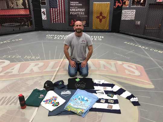 Mixed-martial arts trainer Greg Jackson, of Albuquerque, poses with some of the merchandise he will take to UFC 234, which is Feb. 9, 2019, in Melbourne, Australia.