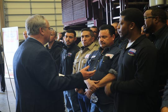 Acting U.S. Secretary of the Interior David Bernhardt shakes hands with workers at an oil and gas facility, Feb. 6, 2019 at Watson Hopper in Hobbs.