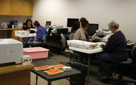 Election workers wait for ballots to come in Tuesday at San Juan County Clerk's Office in Aztec.