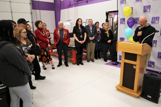 Merrion Oil & Gas President T. Greg Merrion, right, speaks during a ribbon cutting ceremony Tuesday afternoon for  The Big Idea @ SJC, the new makerspace housed in the San Juan College Quality Center for Business.