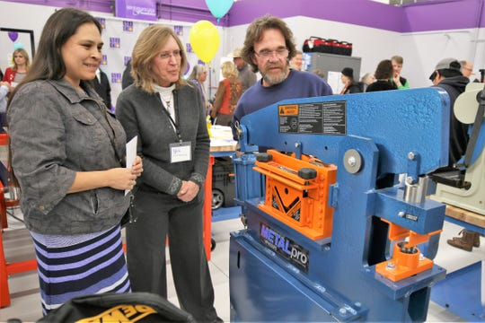 Shannon Teseny, left, San Juan College adjunct instructor Tammy Schreiner, middle, and Fred Byrd examine equipment Tuesday afternoon in the The Big Idea @ SJC makerspace in the San Juan College Quality Center for Business.