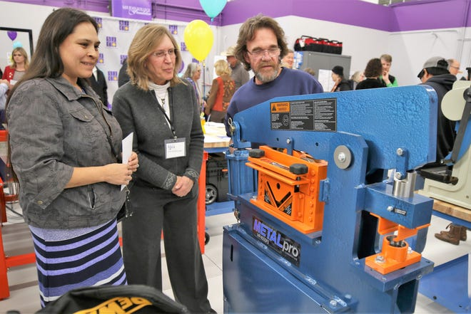 In this file photo, Shannon Teseny, left, San Juan College adjunct instructor Tammy Schreiner, middle, and Fred Byrd examine equipment in the The Big Idea @ SJC makerspace in the San Juan College Quality Center for Business. New grant money will fund new entrepreneurship programs at the center.