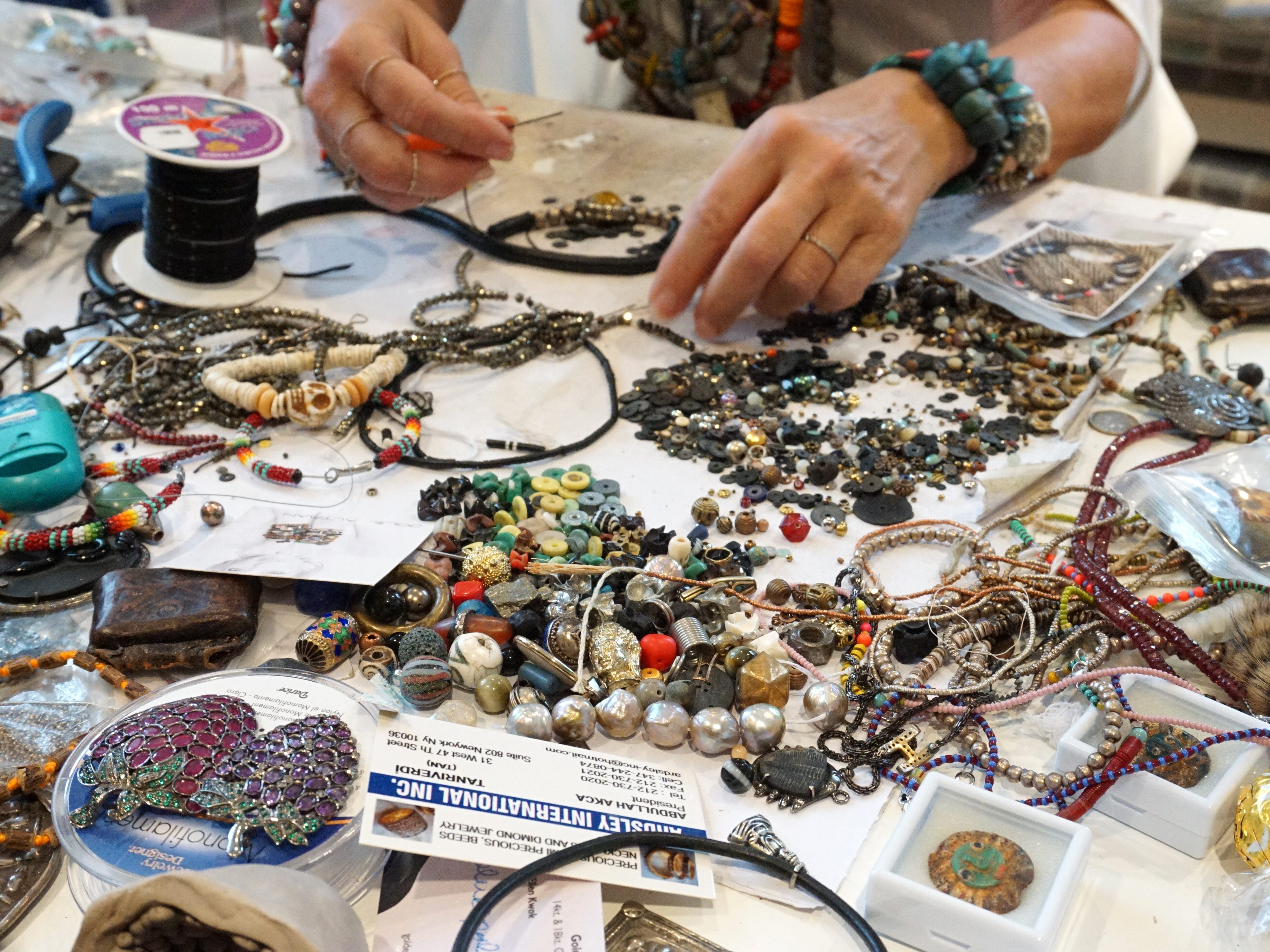 Altman's Birmingham office is busy with lots of beads and stones and other objects that she makes into bracelets and necklaces.