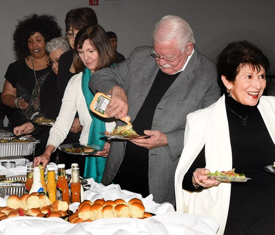In the buffet line at the St. Landry-Evangeline United Way annual banquet held recently at the Delta Grand.