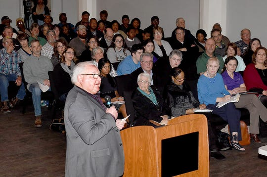 St. Landry Parish President Bill Fontenot addresses the audience at the recently held Eagle Oil Co. public hearing.