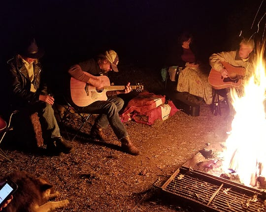 Campfire jam session at the recently held  Peyton Wilson Songwriting Camp held at Chicot State Park.