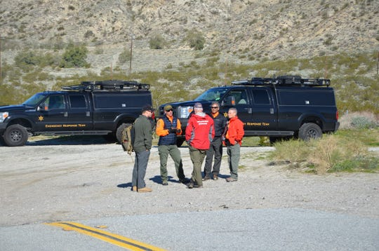 Local authorities convene at the command center for a plane crash near Morongo Valley, Feb. 6, 2019.
