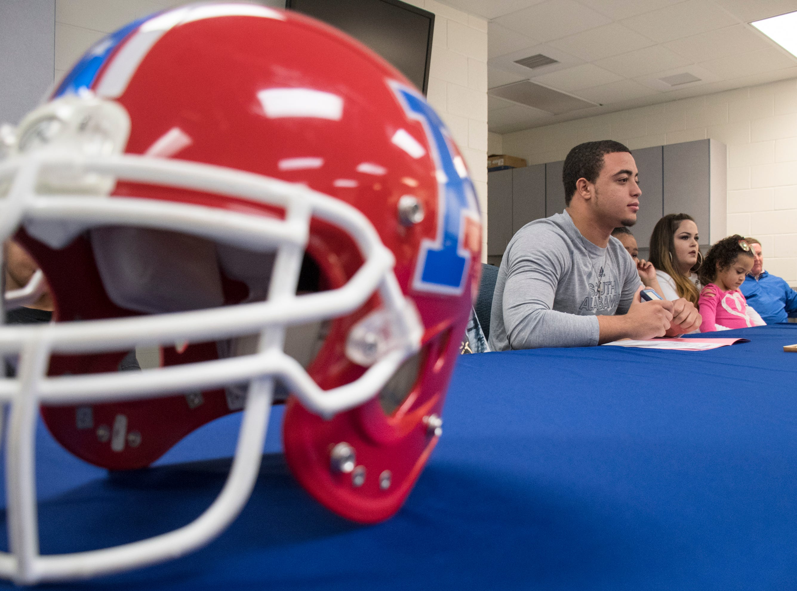 Damean Bivins gets ready to sign his letter of commitment to play football at the University of South Alabama during a ceremony at Pace High School on Wednesday, February 6, 2019.