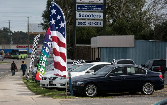 """Escambia County is considering banning out-of-town car dealers from holding pop-up tent sales. As of Wednesday, Feb. 6, 2019, local car dealers support the measure to create """"a level playing field"""" for dealers and to protect consumers."""