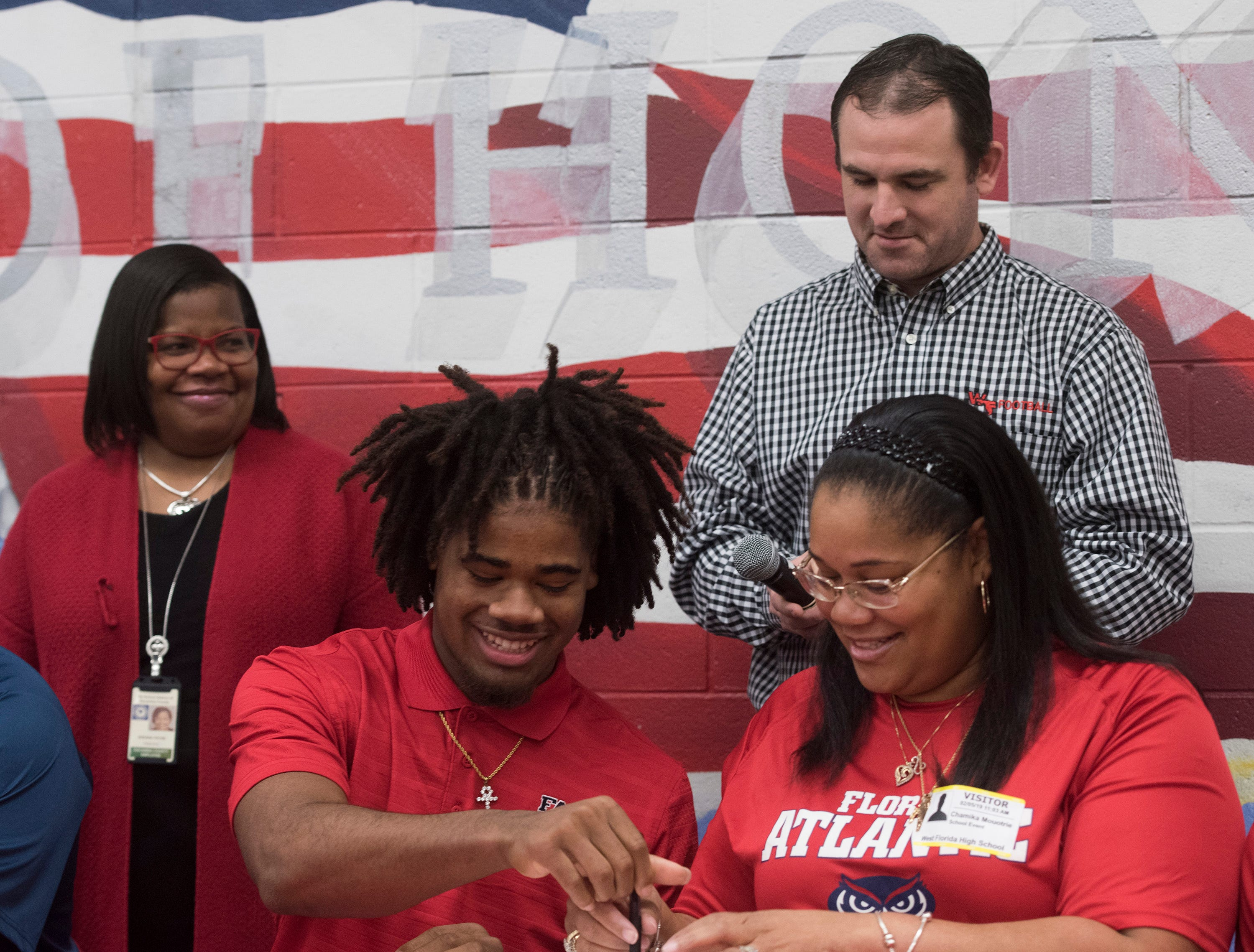 West Florida High School's Antarius Moultrie commits to the Florida Atlantic University on National Signing Day on Wednesday Feb.6, 2019.