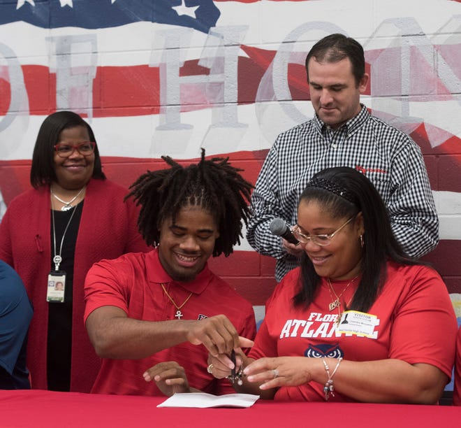West Florida High School's Antarius Moultrie signs to Florida Atlantic University on National Signing Day on Wednesday Feb.6, 2019