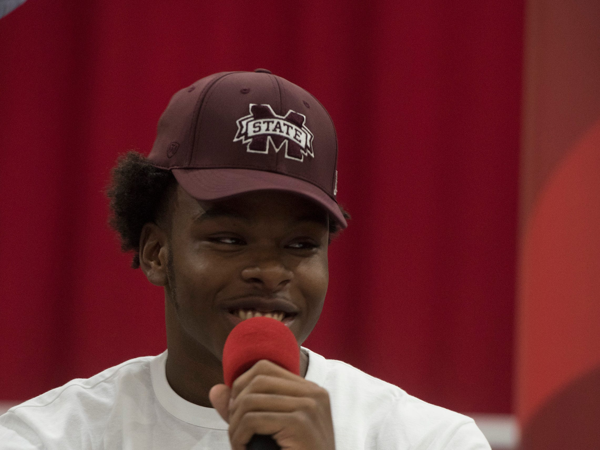 Pine Forest High School's Martin Emerson commits to the Mississippi State University on National Signing Day on Wednesday Feb.6, 2019, as his family and friends look on.