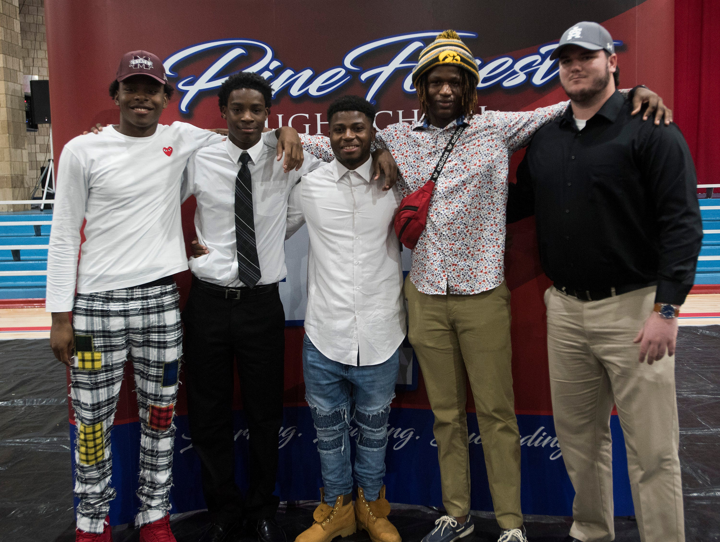The 2019 National Signing Day class at Pine Forest High School High  celebrates their accomplishments during a ceremony at the school on Wednesday, Feb. 6, 2019.