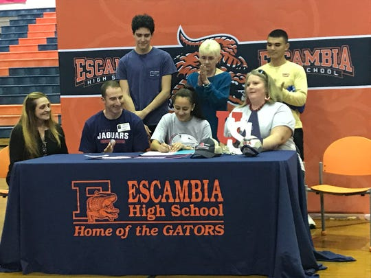 Escambia girls soccer player Brianna Pope (center) signs with South Alabama in a ceremony at Escambia High on Feb. 6, 2018