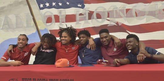 West Florida High School athletes celebrate on National Signing day Wednesday, Feb. 6, 2019.